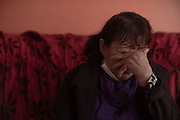 Teresa Salas Carrasco (67) in her home's living room, remembers the disappearance of her youngest daughter Alison Fernandez (30), who on the morning of August 13 went out to the local market and did not return home.