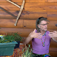 092414      Cayla Nimmo<br /> <br /> Gregory Myers explains how he uses permaculture on his land to grow plants and herbs at the farmer's market in front of the Candy Kitchen Trading Post Wednesday.