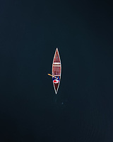Aerial view of a Canadian canoe on the dark waters of Lake Dunstan near Cromwell, Otago Region, South Island, New Zealand