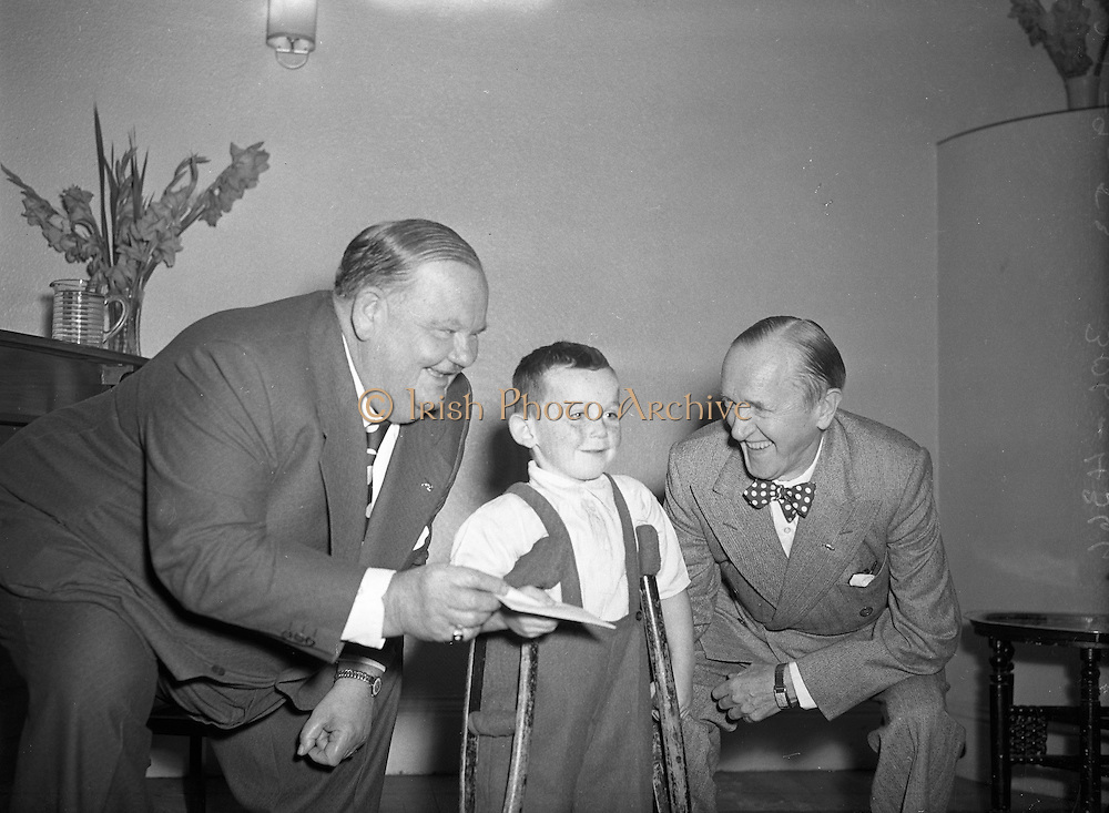 Comedy legends Stan Laurel and Oliver Hardy present cheque on behalf of Premier (DOMAS) to Little Willie Fund. <br /> <br /> 22nd September 1953.<br /> <br /> 22/09/1953
