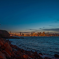 San Francisco gomes aglow in the dusk, viewed from Treasure Island.