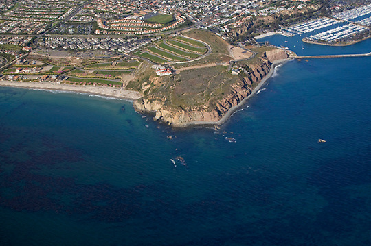 View of Dana Point from the air looking northeast with Dana Harbor off to the right of the image.
