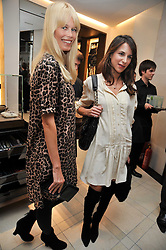 Left to right, Claudia Schiffer and CAROLINE SIEBER at a reception hosted by Vogue and Burberry to celebrate the launch of Fashions Night Out - held at Burberry, 21-23 Bond Street, London on 10th September 2009.