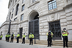 London, UK. 28th August, 2021. Metropolitan Police officers stand outside Unilever's headquarters shortly before the arrival of animal rights activists from Animal Rebellion and other groups taking part in a National Animal Rights March. Animal Rebellion, an offshoot of Extinction Rebellion, organised the march for the sixth day of Extinction Rebellion's protests in London and activists paused outside the headquarters of Unilever due to its ownership of brands which sell dairy products and use palm oil.