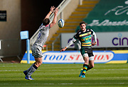 Northampton Saints fly-half James Grayson chips over the stretching Sale Sharks fly-half AJ McGinty during a Gallagher Premiership Round 13 Rugby Union match, Saturday, Mar. 13, 2021, in Northampton, United Kingdom. (Steve Flynn/Image of Sport)