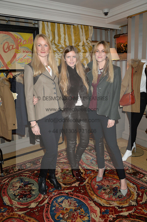 Left to right, ROSIE RUCK KEENE, KATIE READMAN and LUCIA RUCK KEENE at a ladies lunch hosted by Katie Readman for sisters Lucia & Rosie Ruck Keene founders of a new fashion label - Troy, held at 5 Hertford Street, London on 27th January 2015.