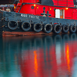 Tugboat alongside the barge, Cape Cod, which is carrying the middle span of the deconstructed Memorial Bridge in Portsmouth, New Hampshire.