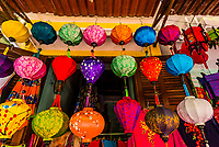 Silk lanterns hang outside a shop, Old Town, Hoi An, Vietnam.
