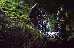 © Licensed to London News Pictures 19/01/2021.        Orpington, UK. Members of the HART team with the casualty at the bottom of the river bank. A person has been rescued from the River Cray in Orpington,South East London tonight (19.01.21) by The London Ambulance Hazardous Area Response Team along with firefighters from the London Fire Brigade.The condition of the person is unknown. Photo credit:Grant Falvey/LNP
