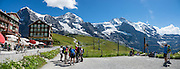"Kleine Scheidegg pass. We walked downhill from Eigergletscher train station (of the Jungfraujoch ""Top of Europe"" railway) under the north face of the Eiger (3970m / 13,020 ft elevation) to Alpiglen station in Grindelwald Valley, Canton of Bern, Switzerland, the Alps, Europe. The Eiger has the biggest north face in the Alps: 1800 vertical meters (or 5900 ft) of rock and ice. The Swiss Alps Jungfrau-Aletsch region is honored as a UNESCO World Heritage Site.The Swiss Alps Jungfrau-Aletsch region is honored as a UNESCO World Heritage Site. This image was stitched from multiple overlapping photos."
