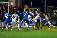 Scramnble in the Peterborough United box during the EFL Sky Bet League 1 match between AFC Wimbledon and Peterborough United at the Cherry Red Records Stadium, Kingston, England on 12 March 2019.