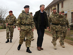 © Licensed to London News Pictures. 09/03/2012. Copedown Hill, UK. (Foreground Left to right) David Richards, Chief of Defence Staff and Secretary of Defence Philip Hammond visit troops during the day. The 12thMechanized Brigade (12 Mech Bde) at Copehill Down, Salisbury Plain Training Area, Wiltshire,on FRIDAY 09 MARCH 2012, as it prepares to deploy to Helmand Province, Afghanistan, on Operation Herrick 16, in the Spring of this year. The Brigade were performing a dynamic demonstration of combined Afghan/ISAF operations supported by surveillance assets and casualty evacuation capability. Tornado GR4 fast jest ground support was also displayed.. Photo credit : Stephen SImpson/LNP