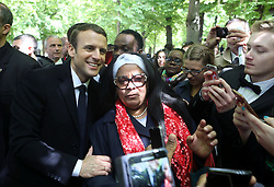 May 10, 2017 - Paris, FRANCE - French president-elect Emmanuel Macron poses for a selfie with residents at the Luxembourg Gardens in Paris on 10 May 2017.  Macron is to be sworn in as head of state next Sunday. (Credit Image: © Maya Vidon-White via ZUMA Wire)
