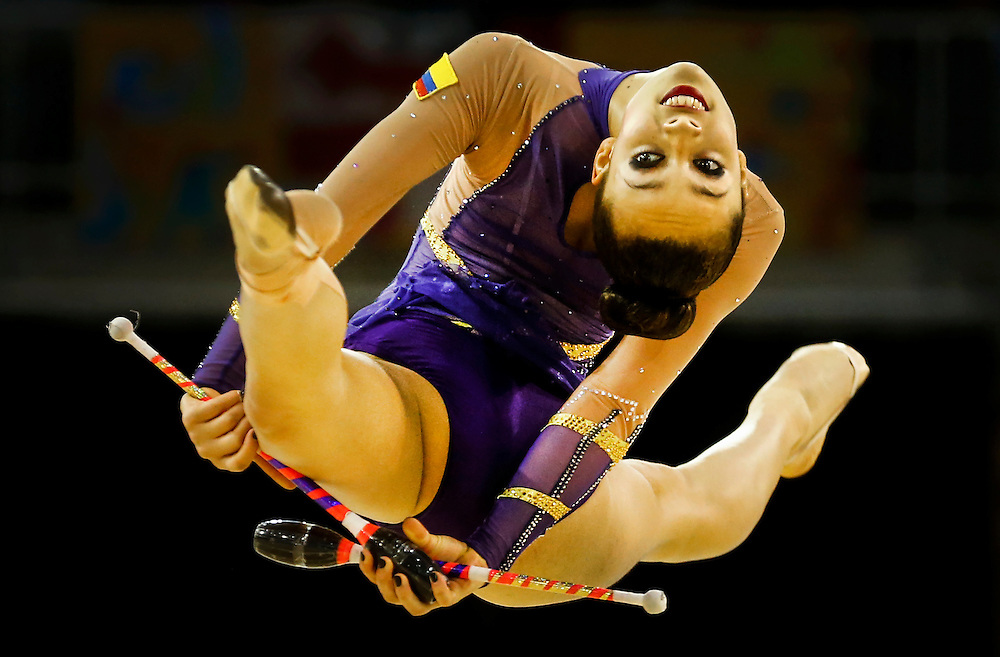 Lina Dussan of Columbia perfroms during the rhythmic gymnastics clubs routine during women's individual all-around at the Pan Am Games in Toronto, Saturday July 18, 2015.    THE CANADIAN PRESS/Mark Blinch