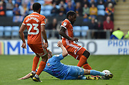 Coventry City midfielder Liam Kelly (6) slides in to tackle Shrewsbury Town midfielder Anthony Grant (42) during the EFL Sky Bet League 1 match between Coventry City and Shrewsbury Town at the Ricoh Arena, Coventry, England on 28 April 2019.