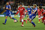 Cardiff city's Federico Macheda (14) breaks away from Jonathan Parr of Ipswich (2) Skybet football league championship match, Cardiff city v Ipswich Town at the Cardiff city stadium in Cardiff, South Wales on Tuesday 21st October 2014<br /> pic by Andrew Orchard, Andrew Orchard sports photography.
