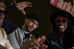 © Licensed to London News Pictures . 07/06/2015 . Manchester , UK . Dynamite MC ( Dominic Smith ) , Roni Size and Onallee backstage at The Parklife 2015 music festival in Heaton Park , Manchester . Photo credit : Joel Goodman/LNP