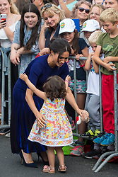 The Duchess of Sussex hugs a young girl during a walkabout in Rotorua on day four of the royal couple's tour of New Zealand.