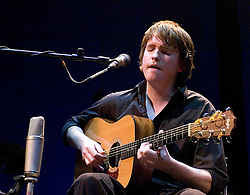 John Smith performing live at The Roundhouse, Chalk Farm, London, Great Britain <br /> supporting John Martyn who was recording Solid Air live at the Roundhouse.<br /> 3rd February 2007.<br /> <br /> John Smith is an English folk guitarist and singer from Devon. He has toured Britain, Europe and America extensively, both solo and with artists such as Iron and Wine, James Yorkston, John Martyn, David Gray, Jools Holland, Gil Scott-Heron and Lisa Hannigan.<br /> <br /> Photograph by Elliott Franks