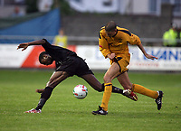 Photo: Rich Eaton.<br /> <br /> Carmarthen Town v SK Brann. UEFA Cup Qualifying. 19/07/2007. SK Brann's Tijan Jaiteh (l) is tackled by Nicky Palmer.