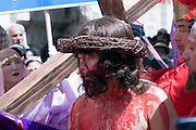 Israel, Jerusalem The Via Dolorosa Procession, Good Friday, Easter 2007 South Korean Pilgrims Re enacting Jesus covered in blood, bearing the Cross on his way to crucifixion. April 06 2007