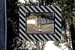 David In Reflection Of Road Mirror