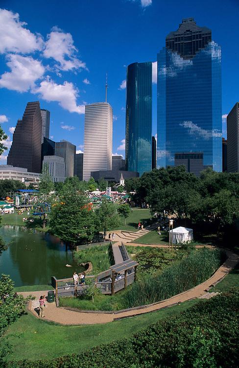 Stock photo of the Houston skyline featuring the International Festival in Sam Houston Park
