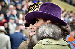 Racegoers pose for a picture during Gold Cup Day of the 2017 Cheltenham Festival at Cheltenham Racecourse. PRESS ASSOCIATION Photo. Picture date: Friday March 17, 2017. See PA story RACING Cheltenham. Photo credit should read: Ben Birchall/PA Wire. RESTRICTIONS: Editorial Use only, commercial use is subject to prior permission from The Jockey Club/Cheltenham Racecourse.