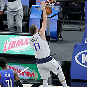 ORLANDO, FL - MARCH 01: Luka Doncic #77 of the Dallas Mavericks slams the ball as Terrence Ross #31 of the Orlando Magic looks on during the first half at Amway Center on March 1, 2021 in Orlando, Florida. NOTE TO USER: User expressly acknowledges and agrees that, by downloading and or using this photograph, User is consenting to the terms and conditions of the Getty Images License Agreement. (Photo by Alex Menendez/Getty Images)*** Local Caption ***  Luka Doncic; Terrence Ross