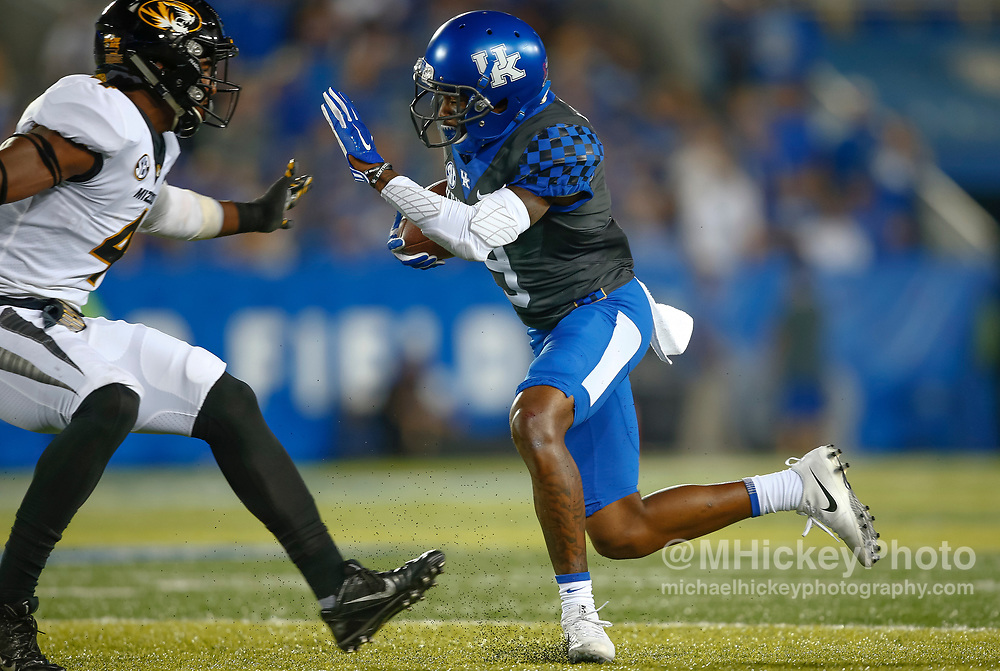 LEXINGTON, KY - OCTOBER 07: Garrett Johnson #9 of the Kentucky Wildcats runs the ball as Brandon Lee #4 of the Missouri Tigers looks to make the stop at Commonwealth Stadium on October 7, 2017 in Lexington, Kentucky. (Photo by Michael Hickey/Getty Images) *** Local Caption *** Garrett Johnson; Brandon Lee
