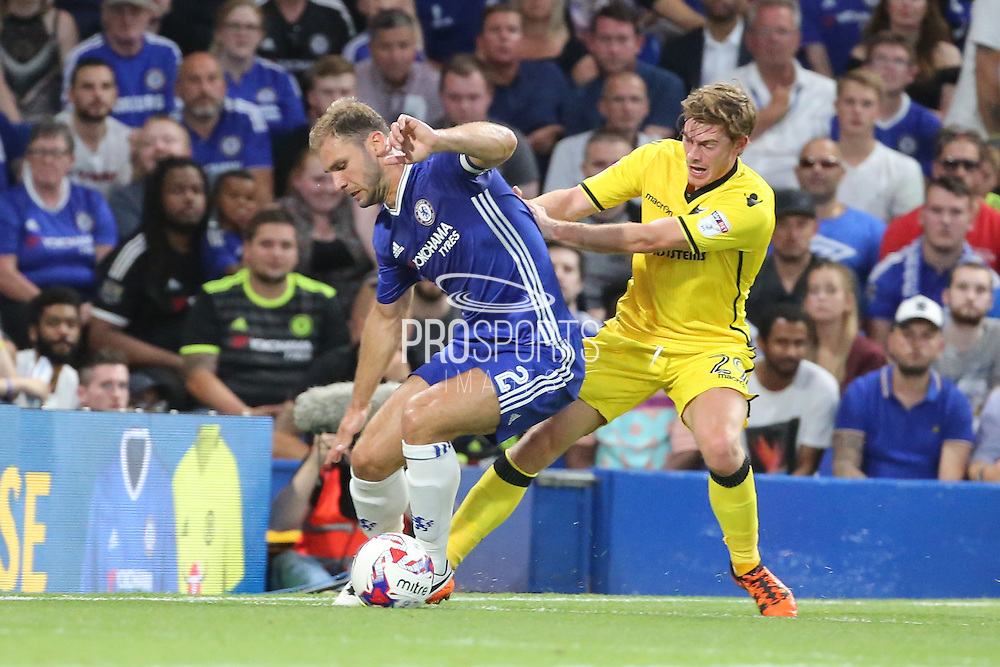Bristol Rovers forward Luke James (29) battles for possession with Chelsea defender Branislav Ivanovic (2) during the EFL Cup match between Chelsea and Bristol Rovers at Stamford Bridge, London, England on 23 August 2016. Photo by Matthew Redman.