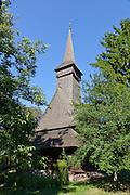 Wooden church from Dragomiresti village.  35m high spire. Built: 1722. Dimitrie Gusti National Village Museum (Muzeul Satului) in Bucharest, Romania
