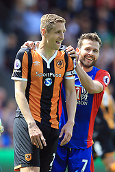 14 May 2017 - Premier League - Crystal Palace v Hull City - Yohan Cabaye of Crystal Palace squeezes the shoulders of Michael Dawson of Hull City - Photo: Marc Atkins / Offside.