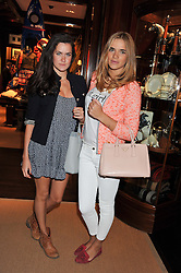 Left to right, ROSIE LONDONER and PHOEBE WATSON at a shopping evening hosted by Kola Karim to celebrate the sport of polo with leading polo player Nacho Figueras at Ralph Lauren, 1 New Bond Street, London on 16th May 2013.