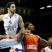 Anadolu Efes's Dogus Balbay (C) and istanbul BSB's Alex Stepheson (2ndR) during their Turkish Basketball League match Anadolu Efes between istanbul BSB at Abdi Ipekci Arena in Istanbul Turkey on Sunday 16 November 2014. Photo by Aykut AKICI/TURKPIX
