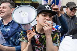 London, UK. 30th March, 2019. A man with a Star of David cap attends a small pro-Israel counter-protest to the Rally for Palestine outside the Israeli embassy to demand freedom, justice and equality for the Palestinian people. The rally was organised by Palestine Solidarity Campaign, Stop the War Coalition, Palestinian Forum in Britain, Friends of Al- Aqsa and Muslim Association of Britain.