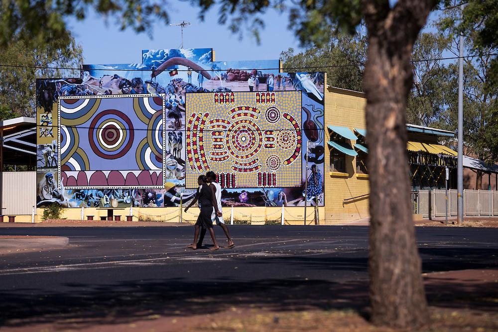 A large wall painted in indigenous art along the main street of Tennant Creek.