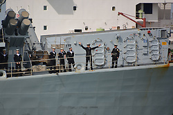 A crew member waves to his loved ones HMS St Albans arrives back at Portsmouth Naval Base following a nine-month deployment to the Middle East.