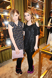 Left to right, CHLOE MORETZ and EMMA ROBERTS at a Cocktail party to celebrate the opening of the new Miu Miu boutique, 150 New Bond Street, London hosted by Miuccia Prada and Patrizio Bertelli on 3rd December 2010.