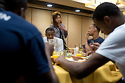 UConn President Susan Herbst speaks with Shabazz Napier and other members of the mens basketball team during a team lunch at the Hyatt Regency in Dallas, Texas before watching her school compete in the NCAA Final Four on April 5, 2014. (Cooper Neill / for The New York Times)