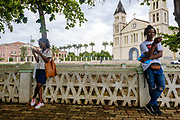 Youngsters searching for wifi near São Tomé's cathedral.