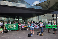 London, UK. 5th June, 2021. Niall Mulholland of Newham Trades Council addresses environmental activists and local residents protesting against the construction of the Silvertown Tunnel. Campaigners opposed to the controversial new £2bn road link across the River Thames from the Tidal Basin Roundabout in Silvertown to Greenwich Peninsula argue that it is incompatible with the UK's climate change commitments because it will attract more traffic and so also increased congestion and air pollution to the most polluted borough of London.