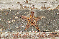 Architectural star brick wall support