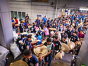 30 AUGUST 2016 - BANGKOK, THAILAND: People wait for their turn to get food and clothing at the Poh Teck Tung Shrine in Bangkok on the last day Hungry Ghost Month. Chinese temples and shrines in the Thai capital host food distribution events during Hungry Ghost Month, during the 7th lunar month, which is usually August in the Gregorian calendar.          PHOTO BY JACK KURTZ