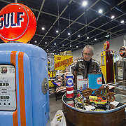 PADOVA, ITALY - OCTOBER 27:  A stall holder arrange his diaplay on October 27, 2011 in Padova, Italy. The Vintage and Classic Cars Exhibition of Padova, running from the October 28 - 30, is the most important European trade show for vintage cars and motorbikes, showcasing over 1600 vehicles.