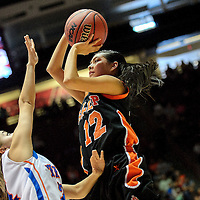 031314  Adron Gardner/Independent<br /> <br /> Gallup Bengal Kaylee Tsinginie (12) lines up a shot over a Los Lunas Tiger during the state high school basketball tournament at The Pit in Albuquerque Thursday.