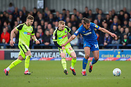 AFC Wimbledon defender Nesta Guinness-Walker (18) battles for possession with Bolton Wanderers midfielder Ali Crawford (11) during the EFL Sky Bet League 1 match between AFC Wimbledon and Bolton Wanderers at the Cherry Red Records Stadium, Kingston, England on 7 March 2020.