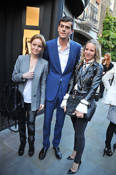 Left to right, RASHA SAID, The HON.ALEXANDER SPENCER-CHURCHILL and ALICE NAYLOR-LEYLAND at a private view of an exhibition of photographs by Mike Figgis entitled 'Kate & Other Women' held at The Little Black Gallery, 13 A Park Walk, London SW10 on 22nd June 2011.