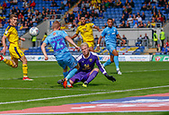 Oxford Unitedl goalkeeper Jonathan Mitchell (32) saves a shot from Coventry City midfielder Luke Thomas (23) on loan from Derby County, during the EFL Sky Bet League 1 match between Oxford United and Coventry City at the Kassam Stadium, Oxford, England on 9 September 2018.