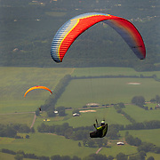 Paraglider Rick Jacob flies over the valley after taking off from Flying Camp Paragliding near Dunlap, Tennessee. Nathan Lambrecht/Journal Communications